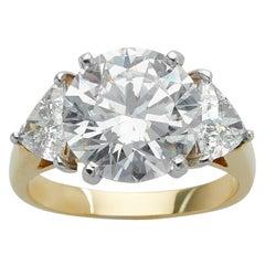 GIA 5.02 Carat Three-Stone 18 Karat Yellow Gold and Platinum Ring