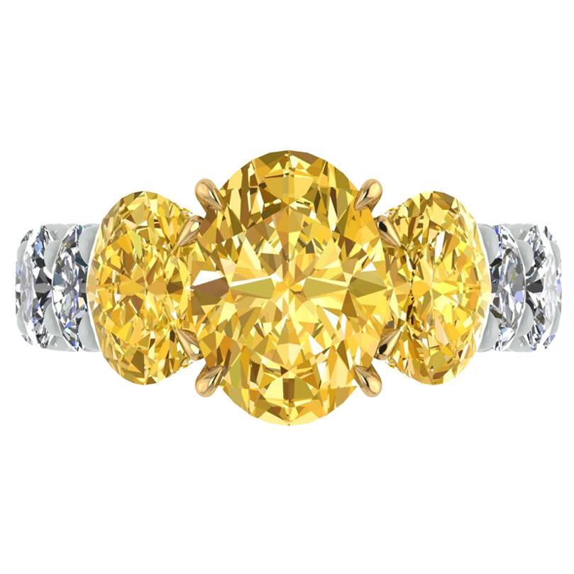 GIA 5.04 Carat Oval Yellow Intense Diamonds 18 Karat and Platinum 950 Ring