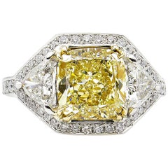 GIA 5.10 Carat Fancy Yellow Cushion Diamond 3-Stone Engagement Ring Platinum