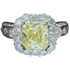 GIA 5.52 Carat Cushion Natural Fancy Yellow Diamond Cluster Halo Ring VVS1