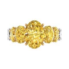 GIA 5.8 Carat Oval Yellow Intense Diamonds 18 Karat Shank Platinum 950 Ring