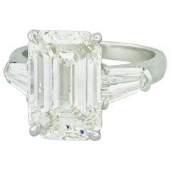 GIA 6.00 Carat Emerald Diamond & 1 Carat Side Diamond Three-Stone Platinum Ring