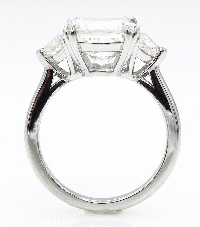 Women's GIA 6.01 Carat Cushion Diamond Three-Stone Engagement Platinum Ring For Sale