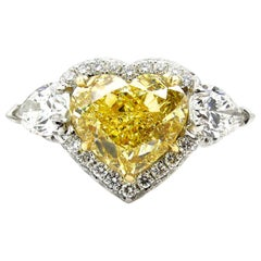GIA 6.16ctw Natural Fancy Yellow Heart Pear Shaped Diamond 3-Stone Platinum Ring