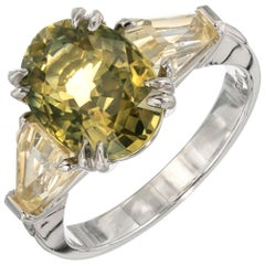GIA 6.46 Carat Green Yellow Sapphire Platinum Three-Stone Engagement Ring