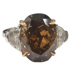 GIA 7.97 Carat Natural Fancy Dark Orange Brown Oval brilliant Diamond Ring.