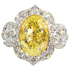 GIA 8.22 Carat Fancy Yellow Oval Diamond 3-Stone Engagement Platinum Ring