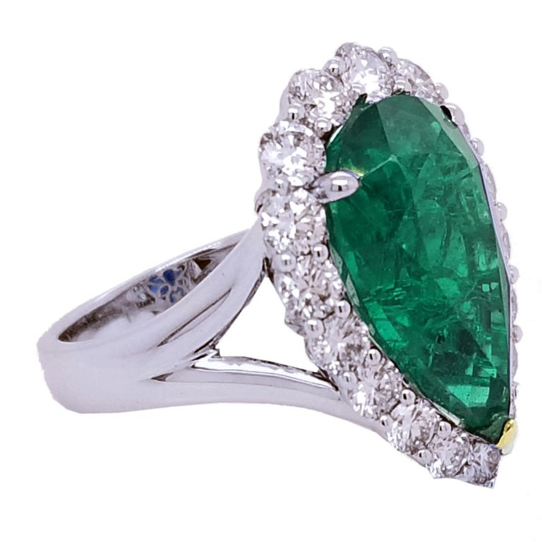 Contemporary GIA 8.90 Carat Pear Shape Emerald Split Shank Engagement Ring with Halo For Sale
