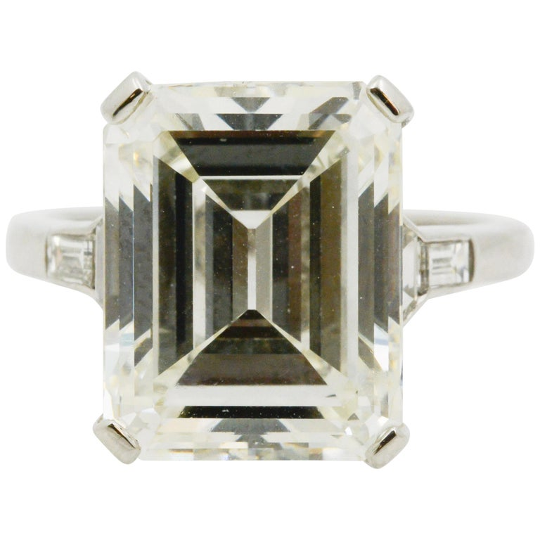 GIA 9.66 Carat Emerald Cut and 5-Stone Diamond Ring For Sale