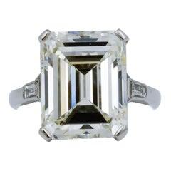 GIA 9.66 Carat Emerald Cut and 5-Stone Diamond Ring