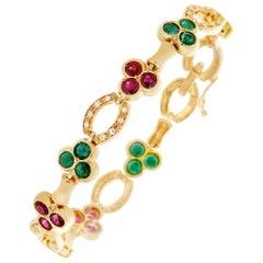 GIA Cert Fred of Paris 7.89 Ruby, Emerald, Diamond Bracelet 18 Karat Yellow Gold
