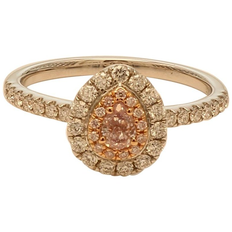 GIA Certified 0.18 Carat Light Pink Pear Shape Halo Diamond Ring For Sale