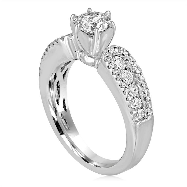 The ring is 14K White Gold The center stone is a Round 0.51 Carats E VS2 GIA Certified The setting has 0.70 Carats in White Diamonds G/H SI The ring is a size 4.5, sizable. The ring weighs 4.4 grams.