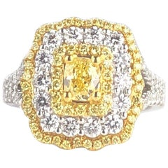 GIA Certified 0.68 Carat Natural Fancy Yellow Diamond Ring in 18 Karat Gold