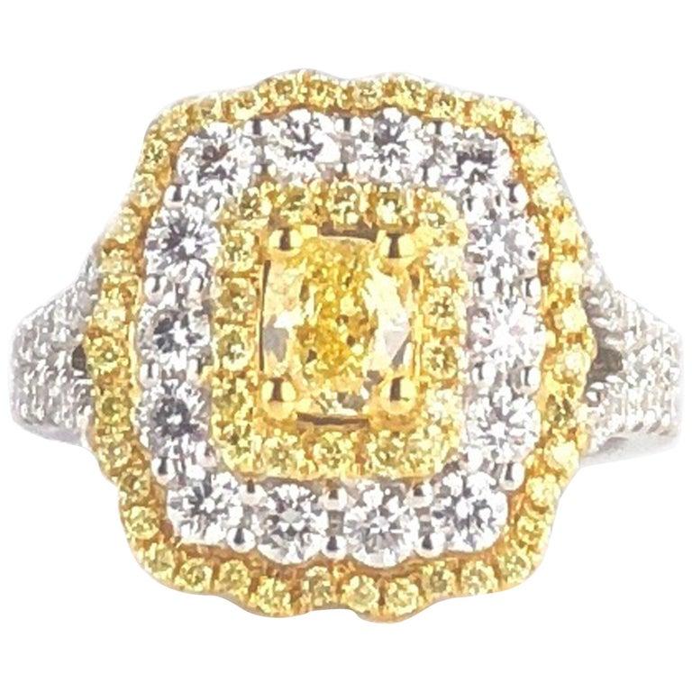 GIA Certified 0.68 Carat Natural Fancy Yellow Diamond Ring in 18 Karat Gold For Sale