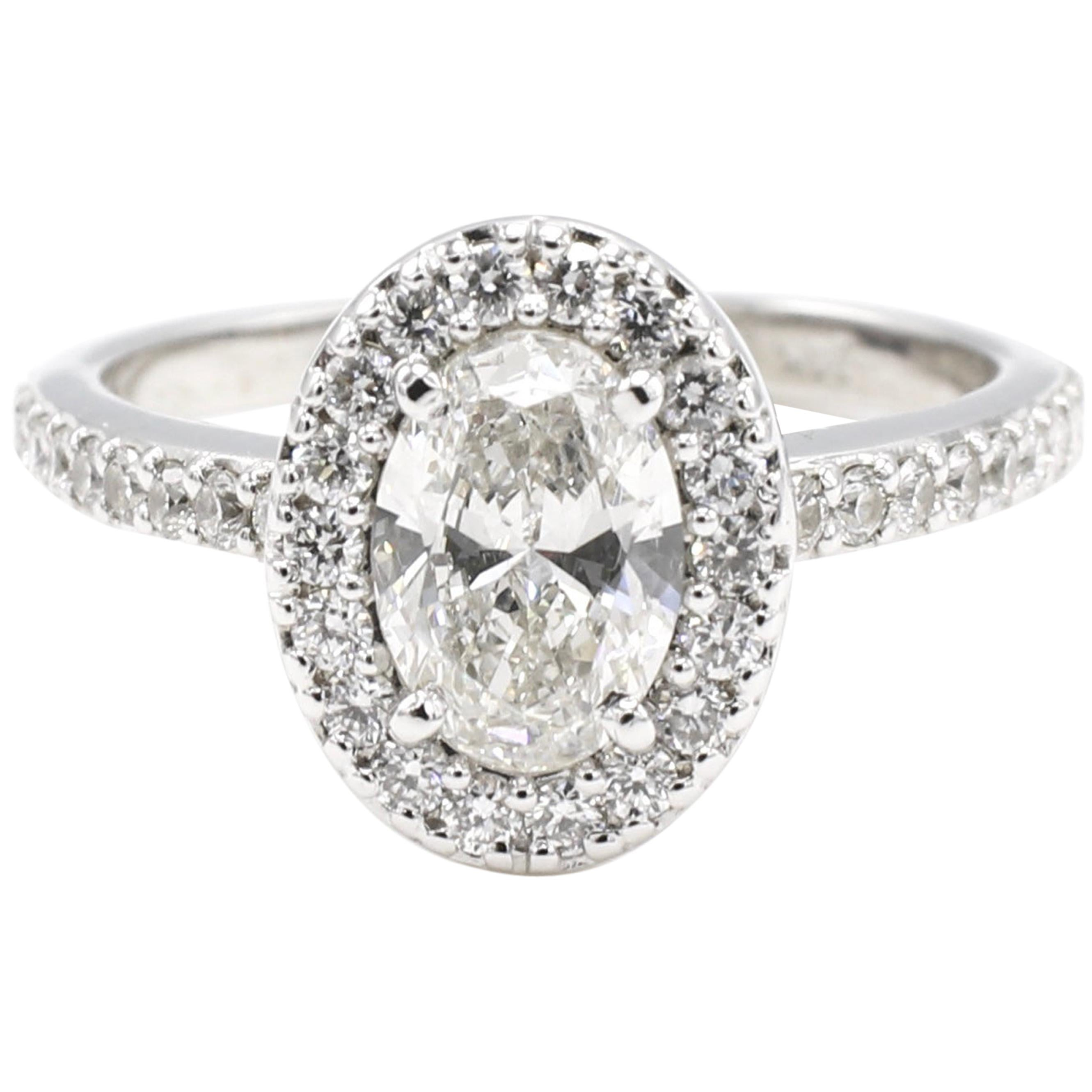GIA Certified 0.73 Carat Oval Diamond Halo Engagement Ring