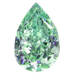 GIA Certified 0.76 Carat Fancy Vivid Green Pear Cut Diamond