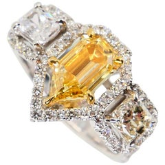 GIA Certified 0.76 Cts Fancy Yellow VS1 Modified Pear Shape Diamond 3-Stone Ring