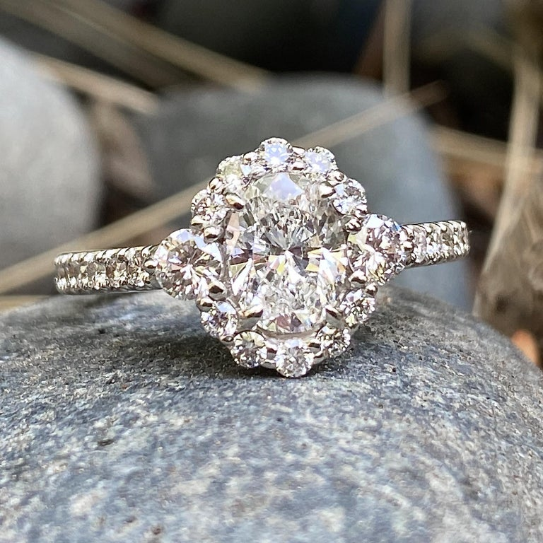 GIA Certified 0.80 Carat Oval Diamond Engagement Ring in White Gold Halo Setting For Sale 1