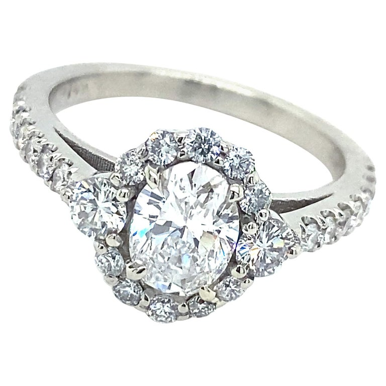 GIA Certified 0.80 Carat Oval Diamond Engagement Ring in White Gold Halo Setting For Sale