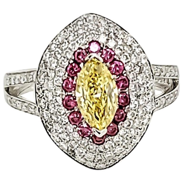 GIA Certified 0.87 Carat Fancy Intense Yellow Marquise Diamond Ring