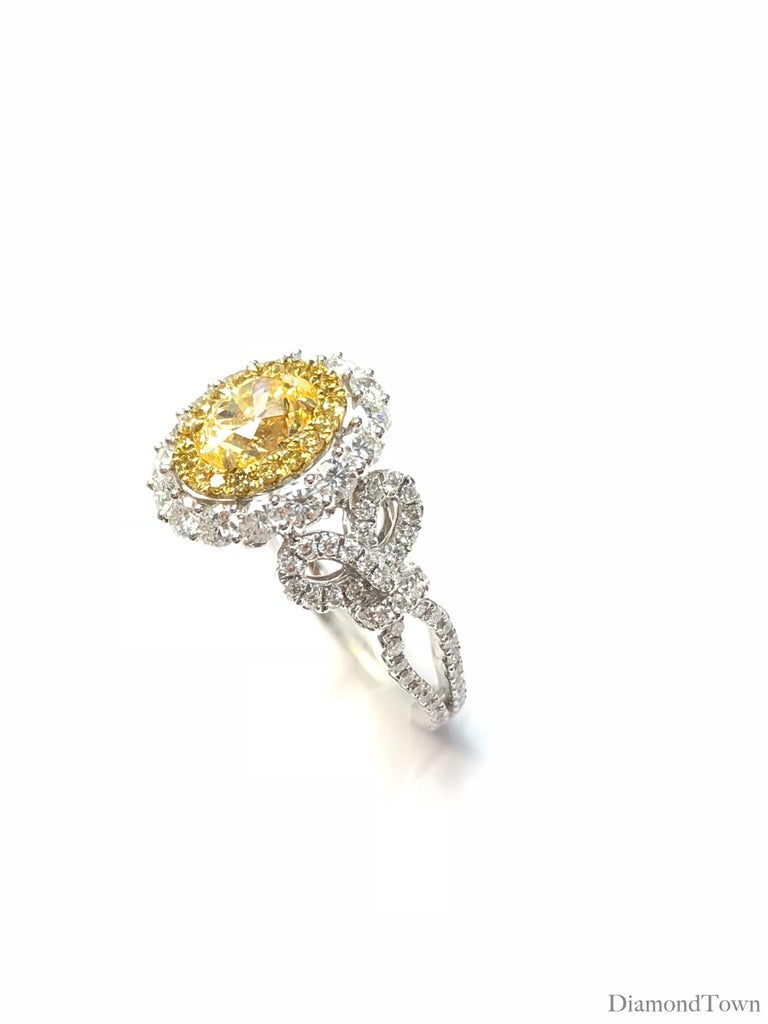 Contemporary GIA Certified 0.98 Carat Oval Cut Natural Fancy Intense Yellow Diamond Halo Ring For Sale