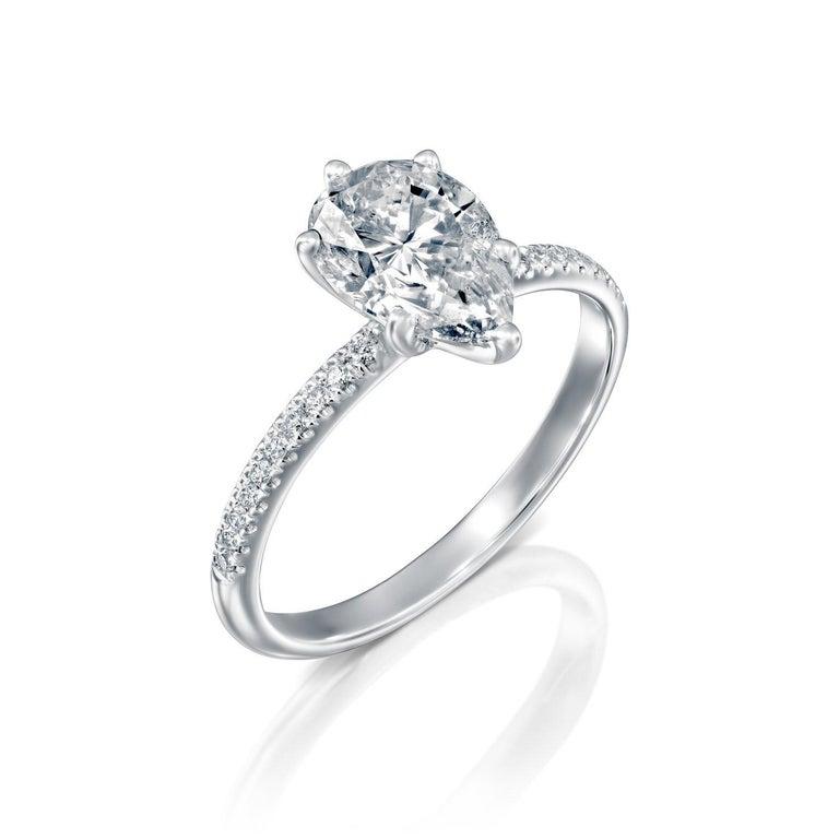 GIA 1 1/2 Carat Pear Engagement Ring, Diamond Engagement Ring, Pear Cut Engagement Ring    Main Stone Name: GIA Certified Diamond  Main Stone Weight: 1.30 ct.  Main Stone Clarity: SI  Main Stone Color: G-H  Main Stone Shape: Pear    Metal: 14K White