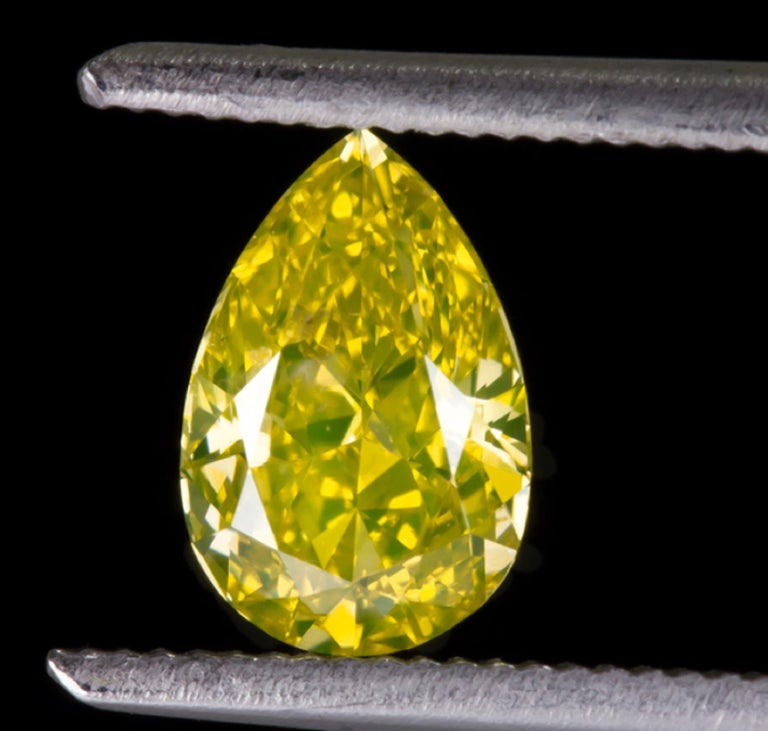 Oval Cut GIA Certified 1 Carat Fancy Vivid Yellow Oval Diamond Platinum Solitaire Ring For Sale