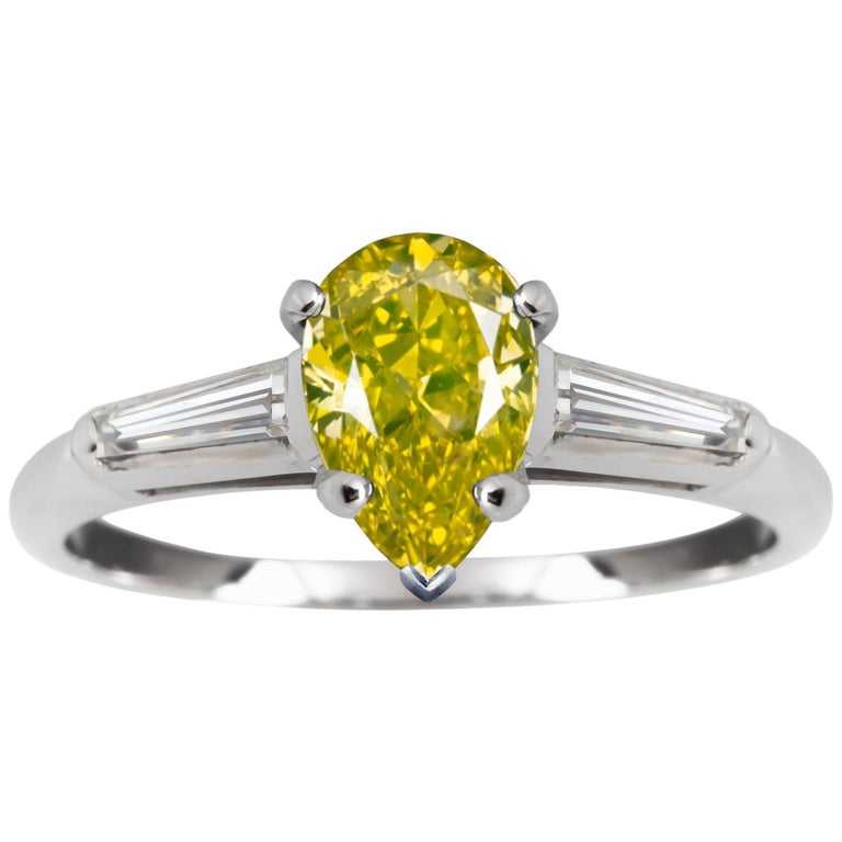 GIA Certified 1 Carat Fancy Vivid Yellow Oval Diamond Platinum Solitaire Ring For Sale