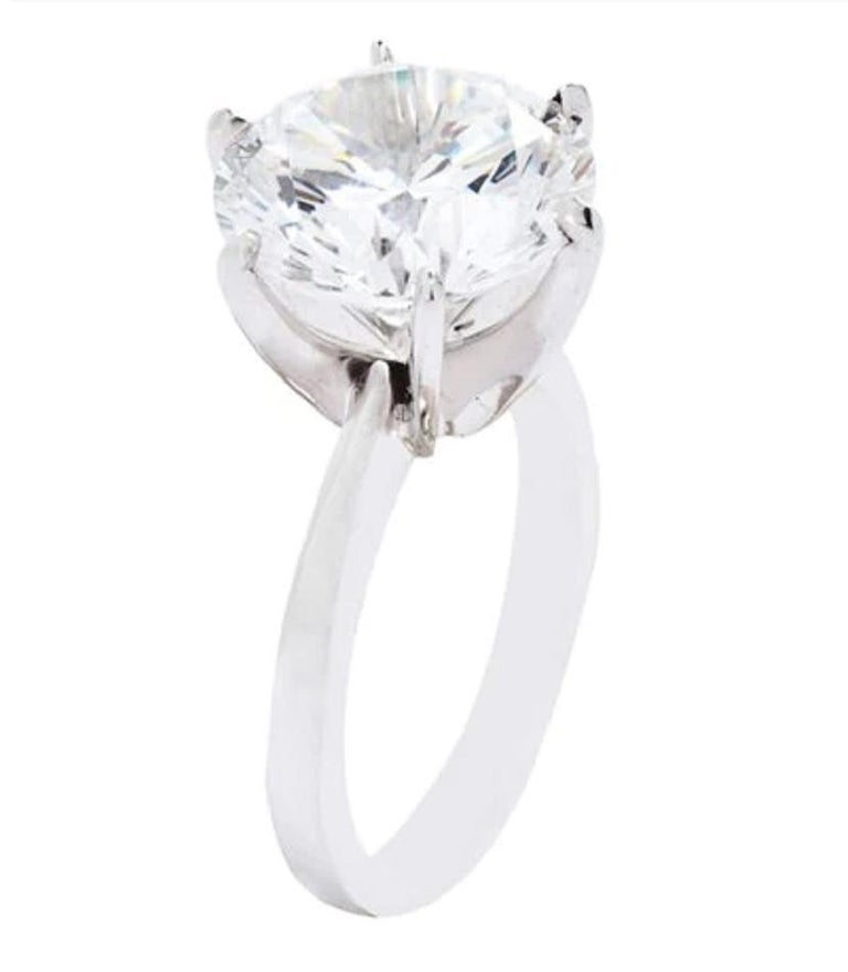 An exquisite and substancial 6 carat round brilliant cut diamond ring with a 6 carat stone  H Color VS2 Clarity excellent symmetry excellent polish none fluorescence