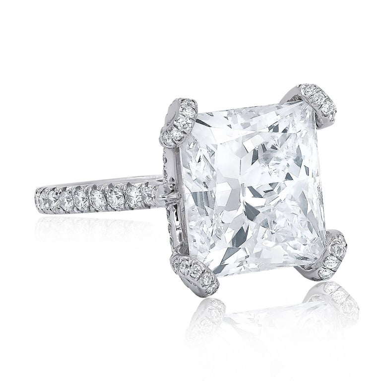 Certified Platinum diamond engagement ring with rectangular modified brilliant cut diamond in the center, weighing 10.02 carat J color/SI1 clarity and accented by 1.00 cts micro pave round brilliant cut diamonds on the side.