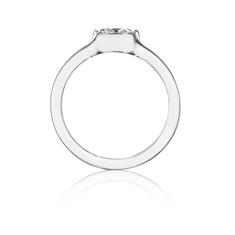 A collet-set diamond ring; mounted in platinum  • 1 cushion-cut diamond, weighing 1.01 carats • Measurements: 3/4 x 1/4 x 13/16 inch • Ring size: 5.5  Certification • Gemological Institute of America Diamond Grading Report stating Diamond is H color