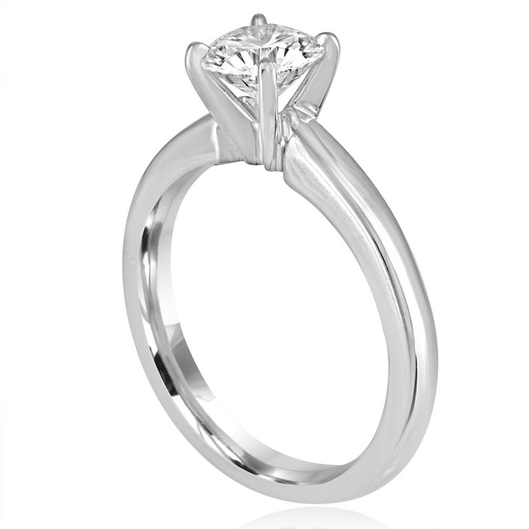 Solitaire Engagement Ring The ring is Platinum The center Is Round Cut Stone, GIA Certified 1.03 Carat F VVS2 The ring is a size 7, sizable. The ring weighs 7.4 grams
