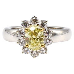 GIA Certified 1.04 Carat Natural Fancy Intense Yellow Oval Diamond Ring