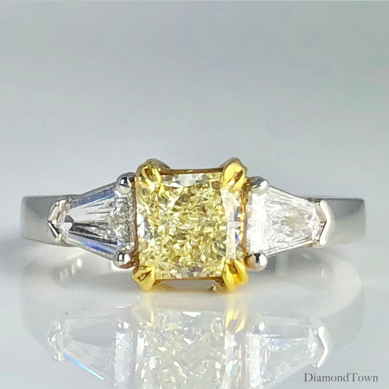 Contemporary GIA Certified 1.08 Carat Fancy Light Yellow Diamond 3-Stone Platinum Ring For Sale