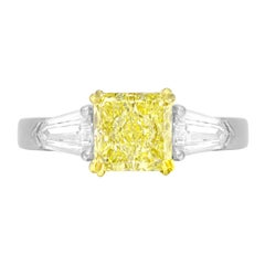GIA Certified 1.08 Carat Fancy Light Yellow Diamond 3-Stone Platinum Ring