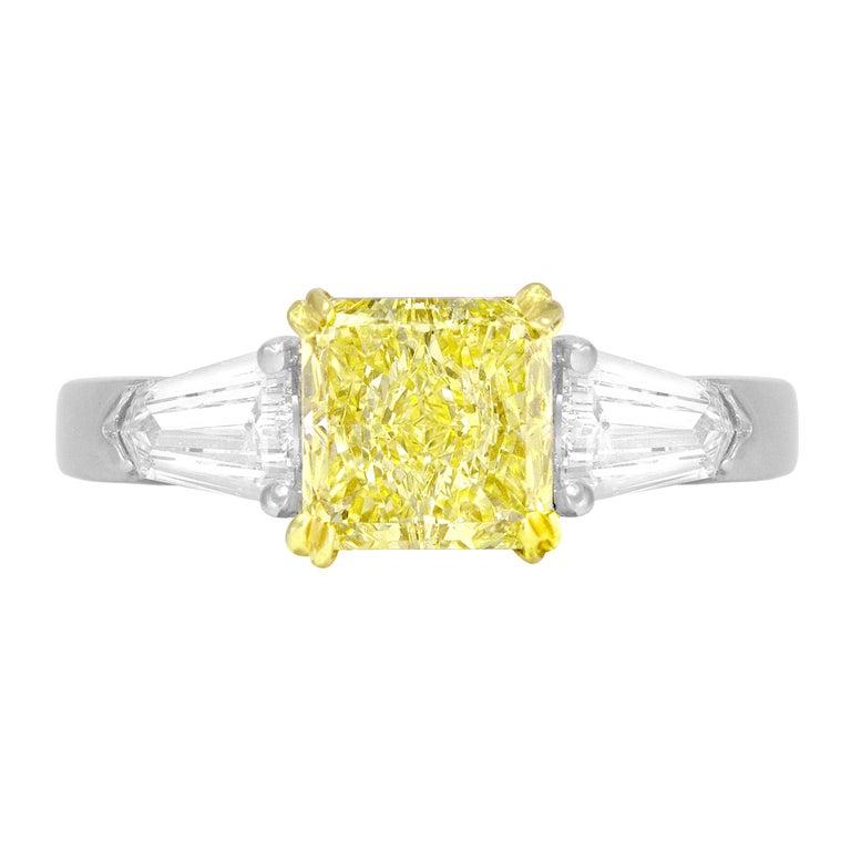 GIA Certified 1.08 Carat Fancy Light Yellow Diamond 3-Stone Platinum Ring For Sale