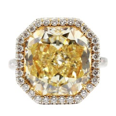 GIA Certified 10.84 Carat Fancy Yellow VVS1 Clarity Radiant Cut White Halo Ring