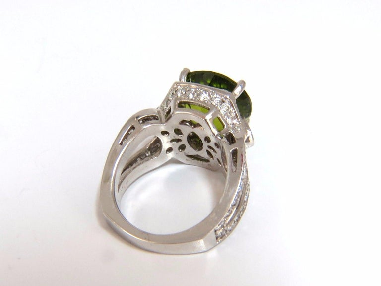 Round Cut Peridot Split Shank Halo  GIA Certified 10.15ct. Natural Peridot ring.  Round brilliant cut, clean clarity & Transparent.  Classic Green Color  12.94 X 13.10 X 9.25mm  GIA # 1172094726 - to accompany  2.00ct Side round diamonds   Full cut
