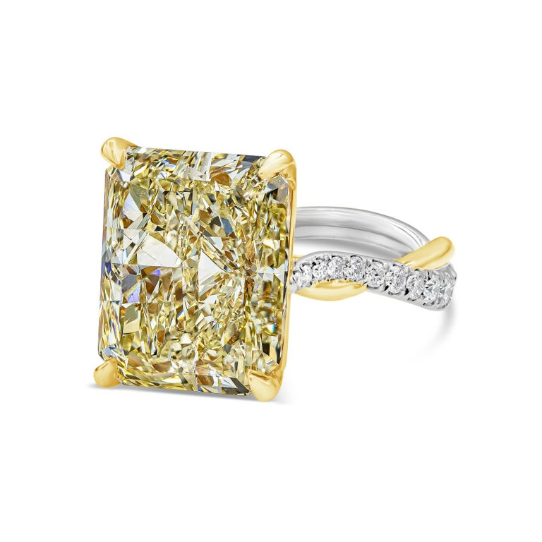 A stylish engagement ring style showcasing a 12.16 carat radiant cut yellow diamond certified by GIA as Fancy Light Yellow, VS1 clarity. The vibrant center diamond is set in a chic intertwined yellow gold and platinum bands accented with diamonds.