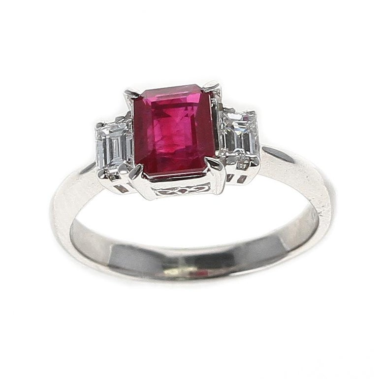 A GIA Certified 1.25 Carat Emerald-Cut Burma Ruby Three-Stone Diamond Ring in Platinum. Diamond Weight: 0.36 carats. Total Weight: 4.29 grams. Ring Size US 5.75. GIA Certificate Available.