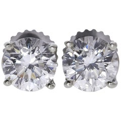 GIA Certified 1.21 Carat Round Diamond Solitaire Stud Earrings in 14 Karat Gold