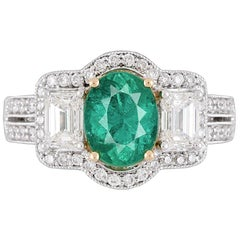 GIA Certified 1.30 Carat Oval Cut Emerald and Diamond Ring in 18 Karat Gold