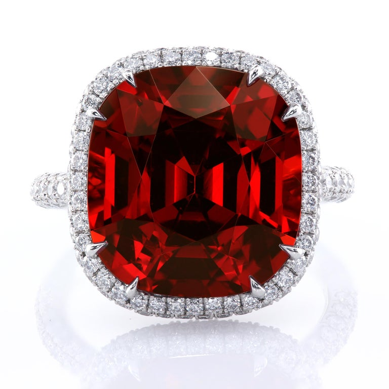 The rich-colored Sangria garnet statement ring in a multi-row diamond pave halo.  Intricate micro pave details encrusting the basket and the shank. 13.63 carat GIA 6173149396 certified natural Spessartine garnet Finger size: US - 6  258 full-cut