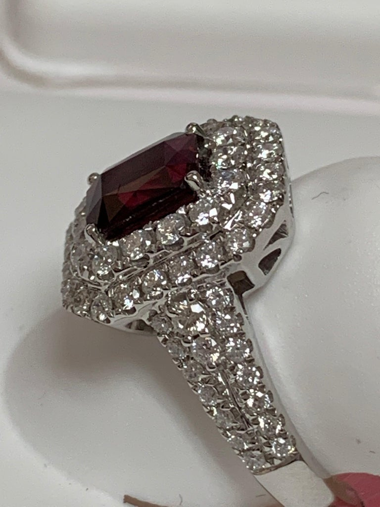 Natural GIA Certified 1.39 Carat Emerald Cut Ruby and 0.94 Carat round white diamonds set in 18  Karat white Gold. The size of the ring is 7 but can be resize if needed.