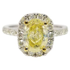GIA Certified 1.42 Carat Fancy Yellow Oval Diamond Ring