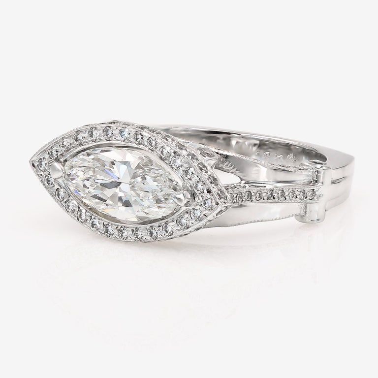Contemporary GIA Certified 1.42cts. Marquise Cut Center and Round Diamond Ring in 18kt WG For Sale