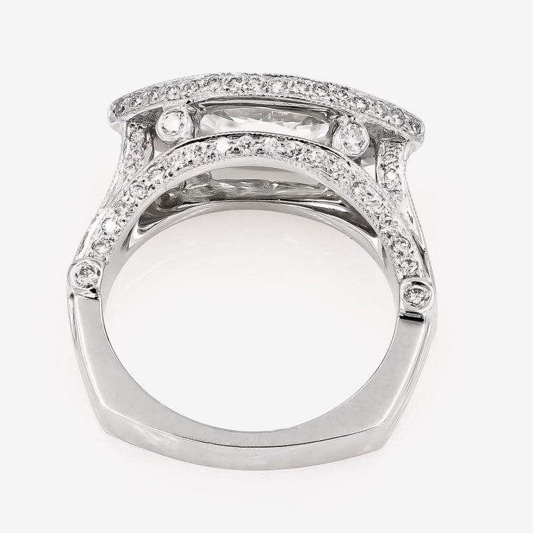 GIA Certified 1.42cts. Marquise Cut Center and Round Diamond Ring in 18kt WG For Sale 1