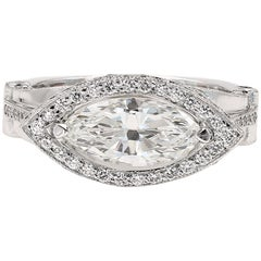 GIA Certified 1.42cts. Marquise Cut Center and Round Diamond Ring in 18kt WG