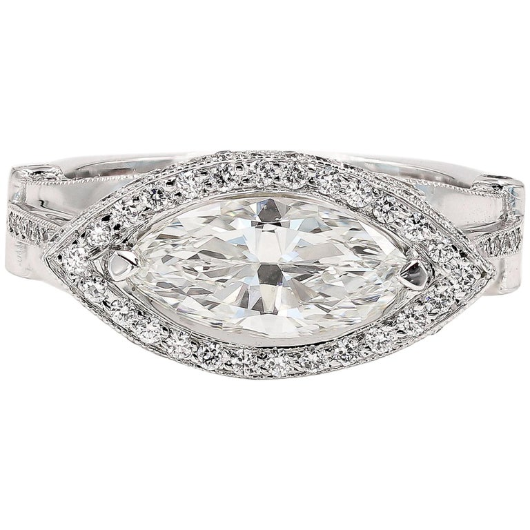 GIA Certified 1.42cts. Marquise Cut Center and Round Diamond Ring in 18kt WG For Sale